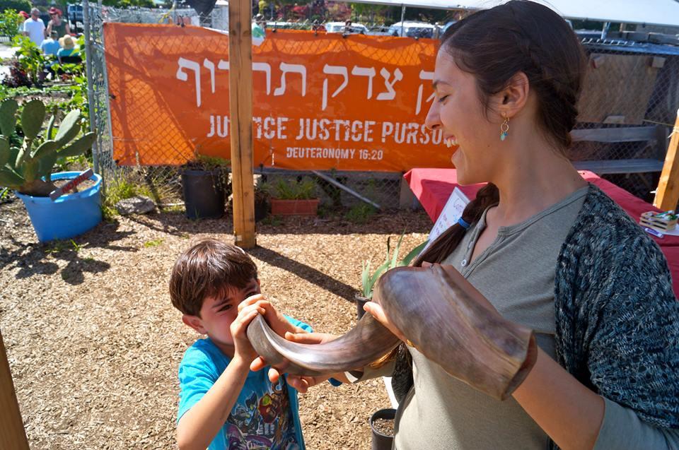Learning to blow shofar at Urban Adamah