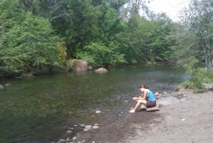 Upper Bidwell Park, Chico, California, sitting by stream