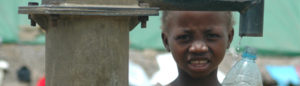 Child at well in Liberia. Photo from American Jewish World Service: http://ajws.org/what_we_do/