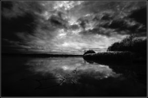 Photo by Stephen Bowlder via Flickr, a dark bay in black and white